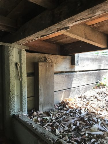 Termites could access the home with no visible evidence from behind the retaining wall.